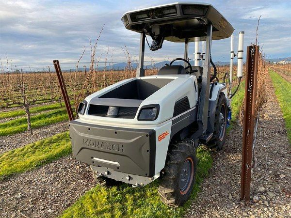 Driverless tractor in a vineyard.